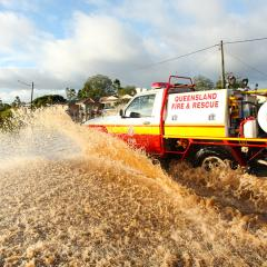 Fire and rescure truck driving through flood waters